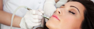 Lady having laser treatment on face